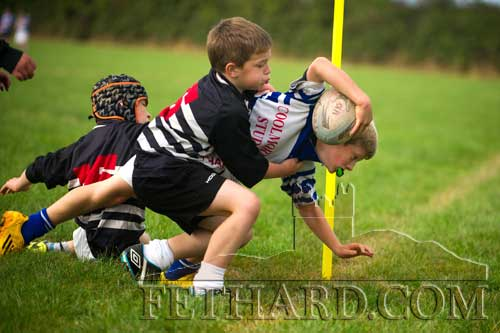Jack Quinlan breaks through two tackles to score a wonderful try for Fethard & District Rugby Club against Thurles in the Under 10 match on Sunday, September 28. (Photo supplied by Kieran Butler)