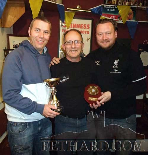 Mark Prout (left) presenting Noel Sharp (centre) with cup after winning The Castle Inn Masters Darts Championship in Fethard last weekend. Also included is Ronan Maher (The Castle Inn). The Shield Competition was won by 'Spud' Culligan who beat Andrew Maher in the final. Trophies were sponsored by NS Woodcraft.