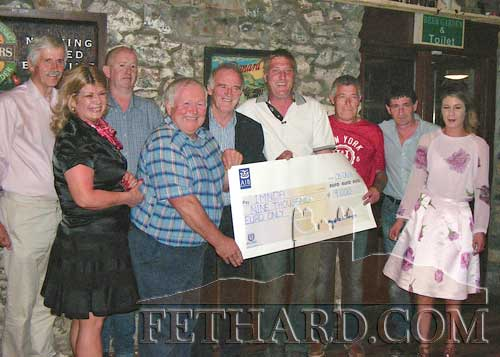 Presentation at The Village Inn, Moyglass, of a cheque for €9,000, proceeds of the recent fundraiser held at Moyglass Community Hall in aid of IMNDA (Irish Motor Neurone Disease Association). L to R: Michael McCormack (IMNDA) Martina Blake, Kevin O'Dwyer, Pat Morrissey, Patsy O'Connor (IMNDA), Tom Shanahan, Liam Sweeney, Pat Keaveney and Roisin Blake.