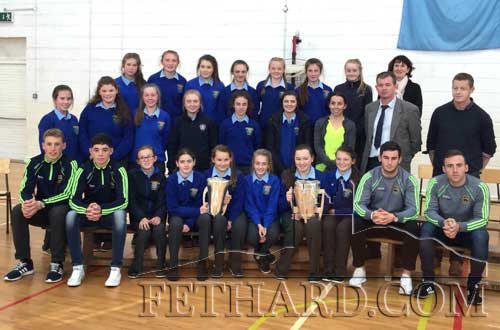 Fethard Patrician Presentation Secondary School pupils photographed with the All-Ireland senior and minor hurling cups won this year by Tipperary when team members visited the school last week. The minor team was represented by captain Brian McGrath and Dylan Walsh; and the senior team represented by Cathal Barrett and John O'Keeffe.
