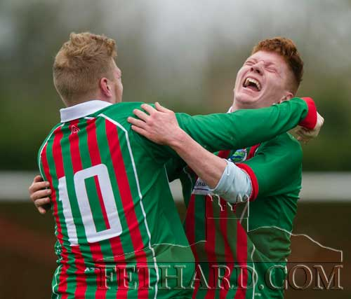 Brotherly love . . . Wayne and Ashley Laslett celebrate scoring Mullinahone's second goal in the Peter O'Reilly Cup final played against Killusty at Newhill Park